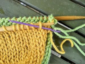 purlwise into next stitch