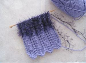 Holding eyelash double with another yarn creates a tactile texture