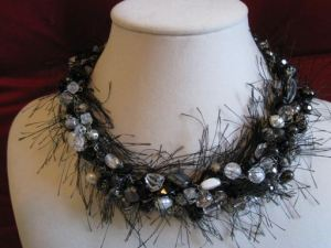 Eyelash yarn added to beads to create a striking necklace on Etsy